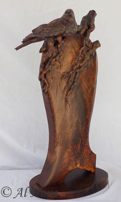 Dove on  branch wood sculpture