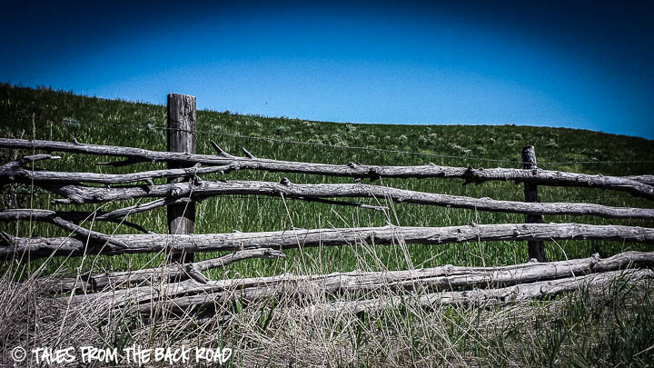 Cool old fence around a green pasture