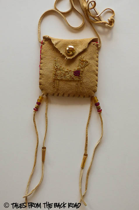 A beaded medicine pouch with a horse
