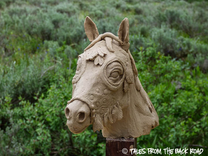 A small sculpture of a horse mask