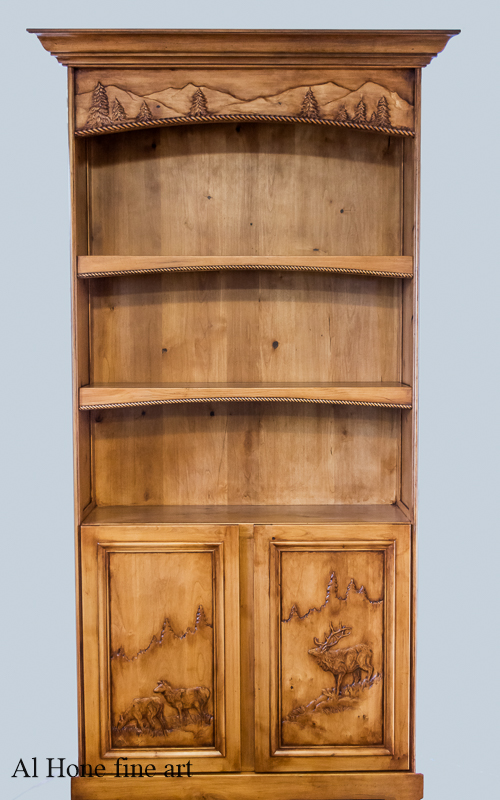 Custom carved bookcase with elk