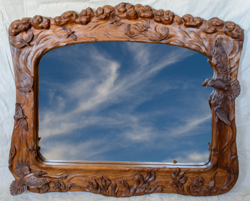 handcarved mirror with ravens