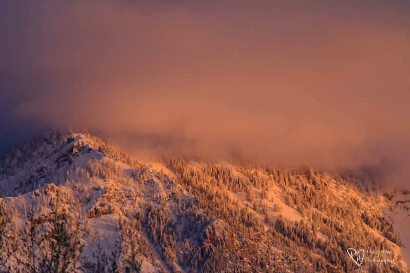 sunset on snowy mountain